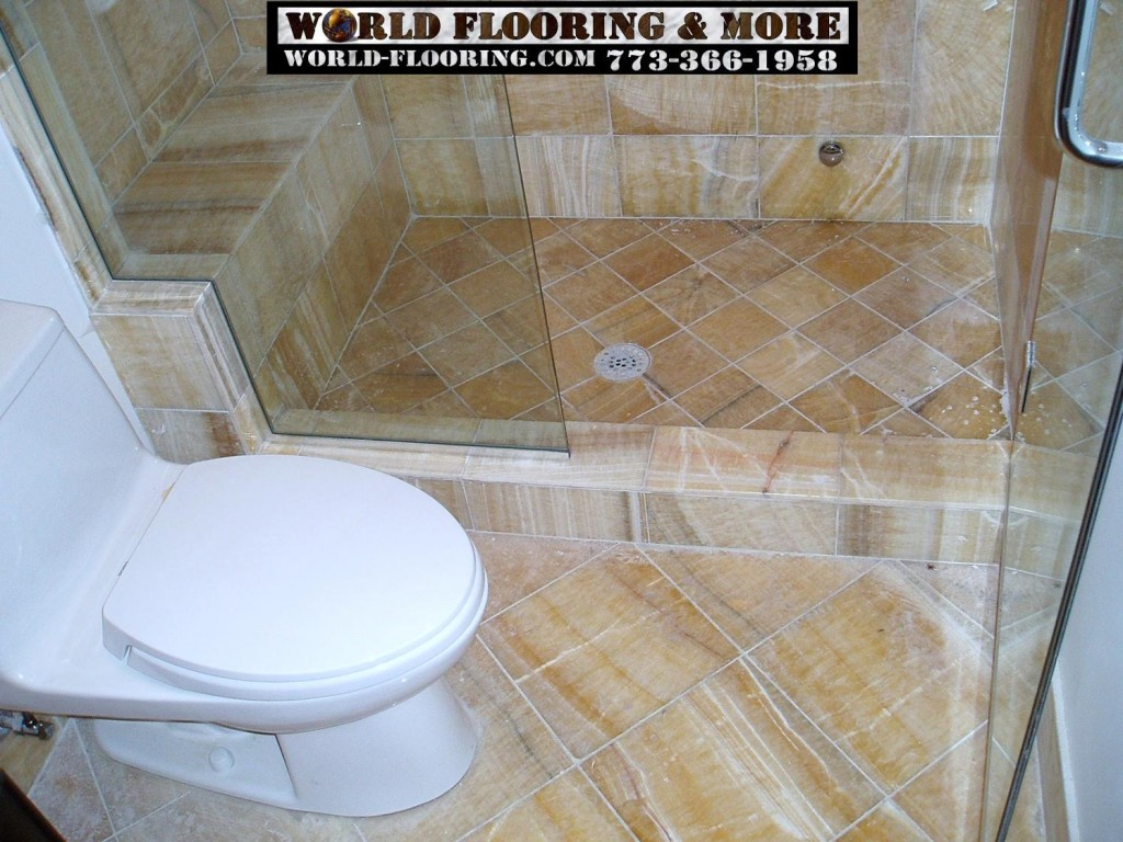Cultured Marble shower seat raised wall by World Flooring & More 773-366-1958 Chicago Suburbs