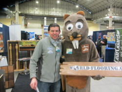 The World Flooring & More mascot with owner