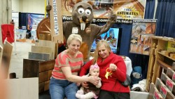 mascot with baby and grandmother