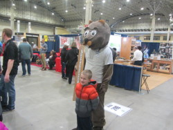 flooring mascot with a boy at a expo exhibit