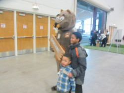 Beaver mascot with children at a fair