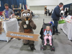 Baby girl with beaver mascot from a floor installation firm
