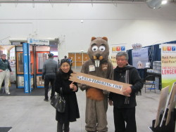 mascot taking pictures with visitors