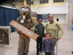 Dad with sons and the beaver mascot